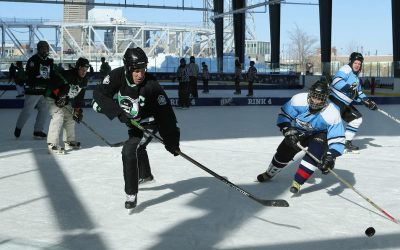 The Oakland Hitmen and the IceWolves- Cody compete against each other on the opening day of the Labatt Blue Buffalo Pond Hockey Tournament is underway at Buffalo RiverWorks, Feb. 20, 2015.  (Derek Gee/Buffalo News)